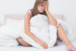Woman has just waking up in the white bedroom